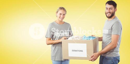 Composite image of portrait of smiling volunteer holding clothes donation box