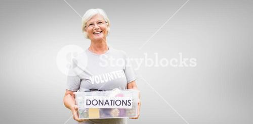 Composite image of happy grandmother holding donation box