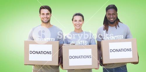 Composite image of happy volunteers with donation boxes in park