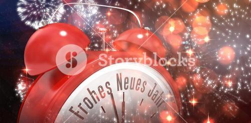 Composite image of frohes neues jahr in red alarm clock