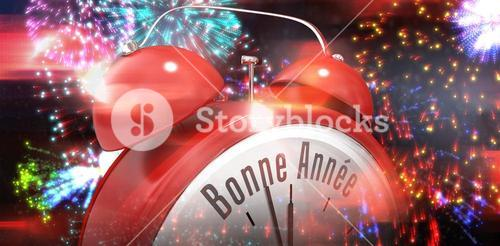 Composite image of bonne annee in red alarm clock