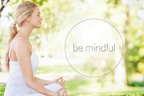 Composite image of mid section of calm young woman meditating