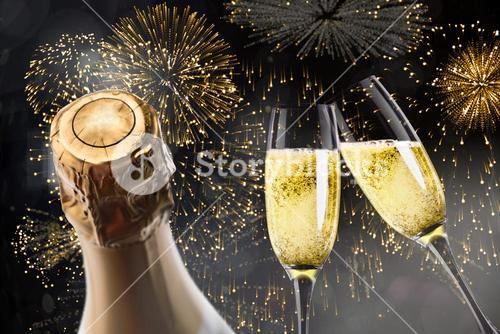 Composite image of champagne glasses clinking