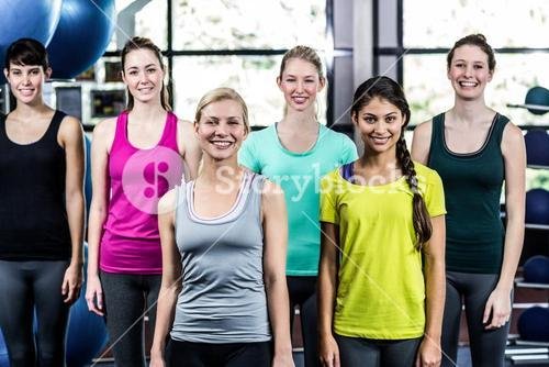 Fit smiling group standing straight