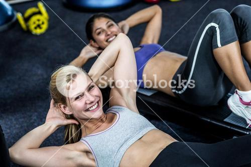 Pretty women working their abs