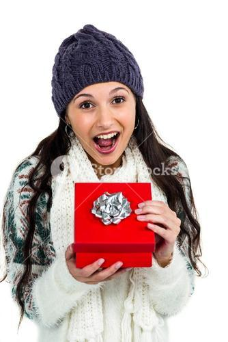 Surprised woman opening red gift box