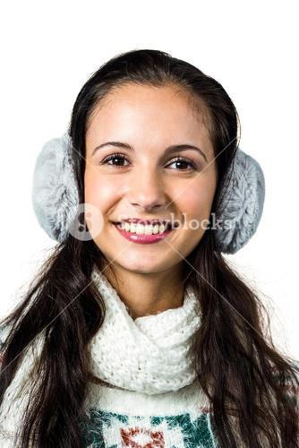 Smiling woman with earmuffs