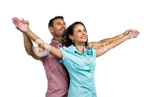 Cheerful couple with arms outstretched