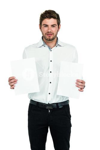 Standing man showing white papers