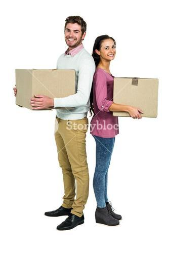 Smiling couple holding boxes