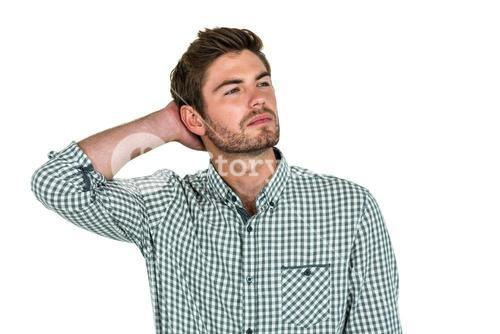 Thoughtful man with hand behind head