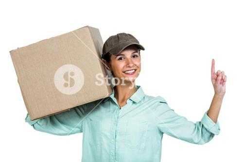 Smiling delivery woman holding box pointing up