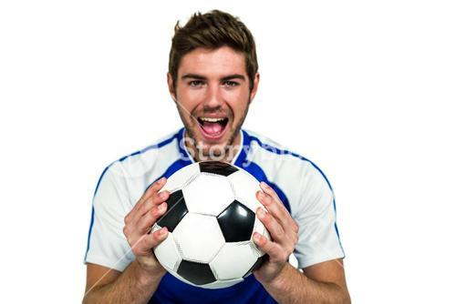Portrait of man holding football with mouth open