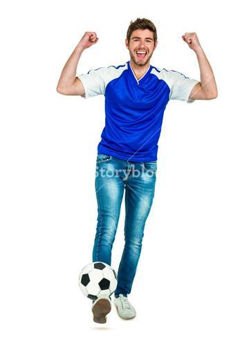 Smart man holding football with arms raised