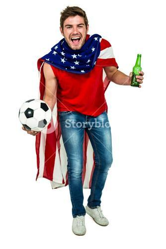 Handsome sport man rejoicing holding football ball and beer