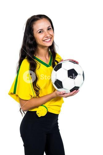Attractive supporting woman holding football