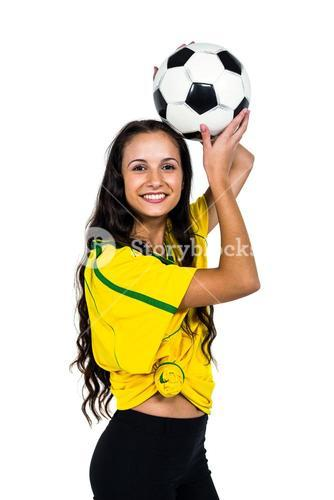 Smart supporting woman holding football