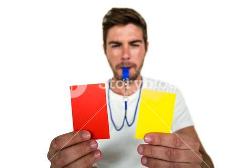 Handsome supporter showing red and yellow cards