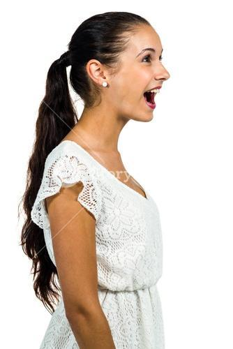 Surprised young woman with open mouth looking up