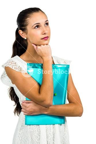 Thoughtful woman holding plastic folder with fist on chin