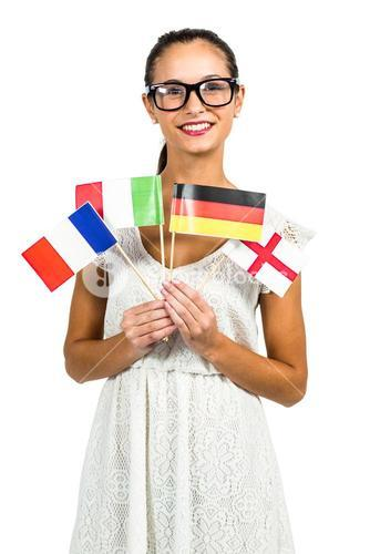Smiling woman with eyeglasses holding flags