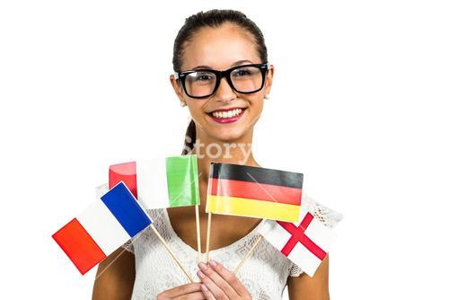 Young woman with eyeglasses holding flags