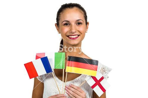 Happy woman holding flags