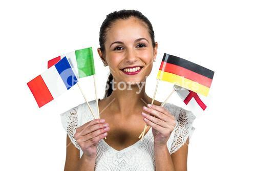 Confident woman holding flags