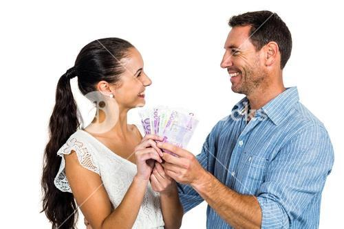 Smiling couple holding money