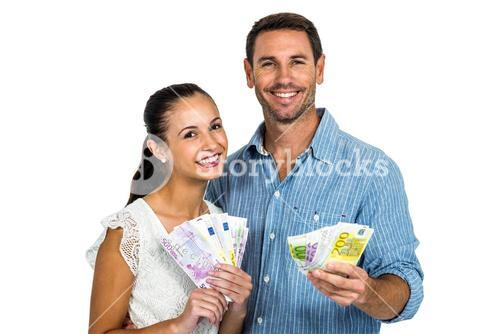 Young couple holding money