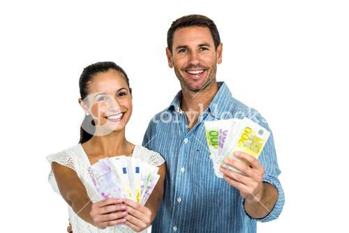 Confident couple holding money