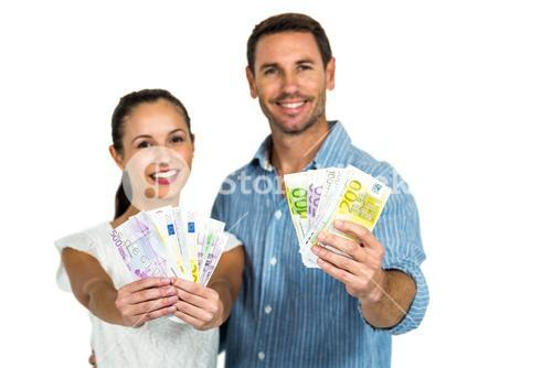 Portrait of couple holding money