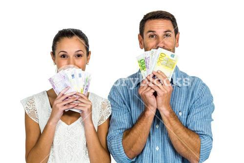 Excited couple holding money
