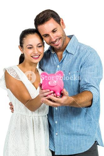Young couple holding piggybank