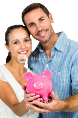 Portrait of couple holding piggybank