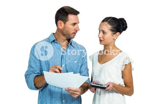 Worried couple calculating bills