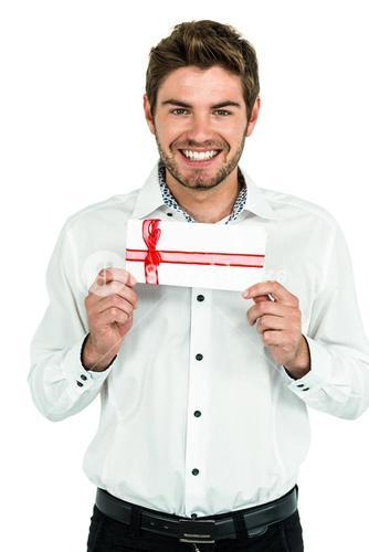Handsome man holding gift box