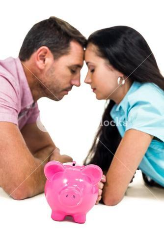 Worried couple laying on the floor face to face with piggybank