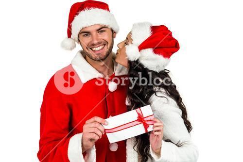 Festive couple exchanging a gift