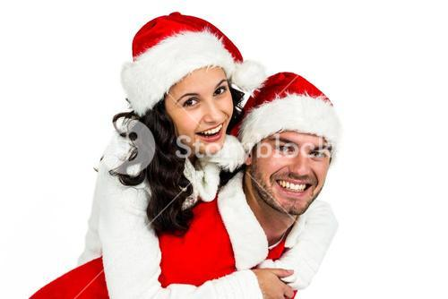 Festive couple smiling at camera