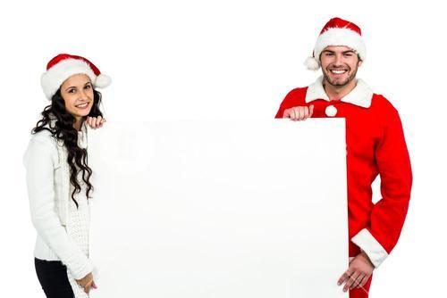 Festive couple showing a poster