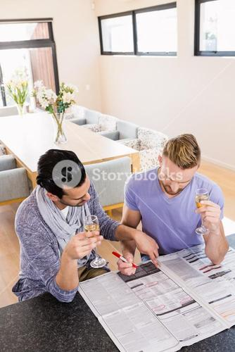 Smiling gay couple surrounding ads