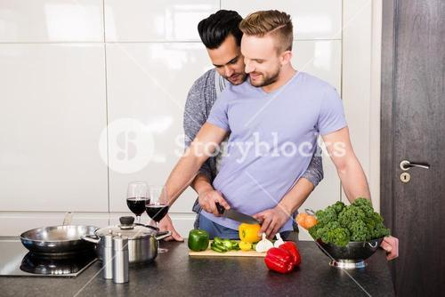 smiling gay couple preparing food