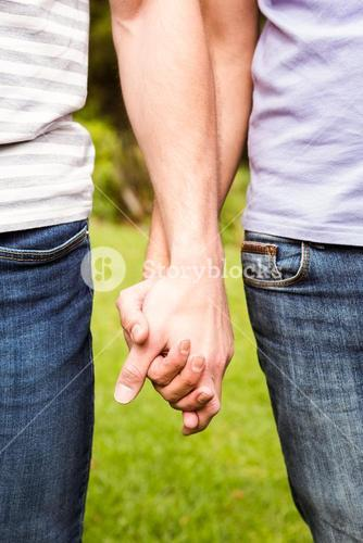 Close up view of gay couple with hand in hand