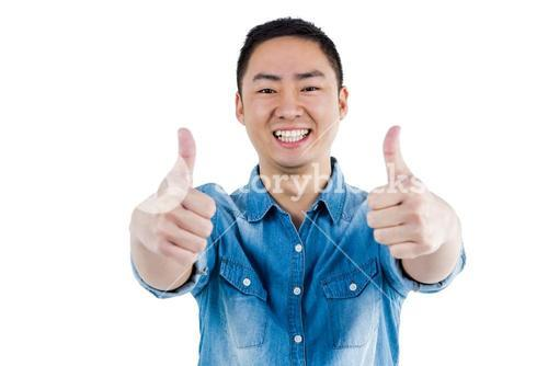 Portait of man showing thumbs up