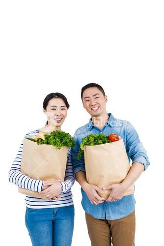 Couple holding grocery bags