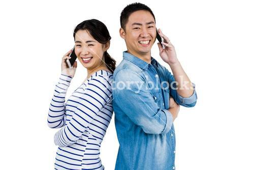 Portrait of happy couple talking on phone