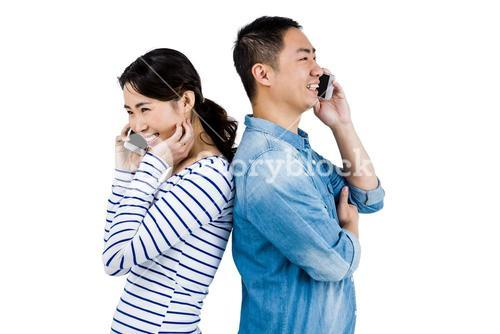 Happy couple talking on phone