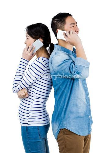 Cheerful couple talking on phone