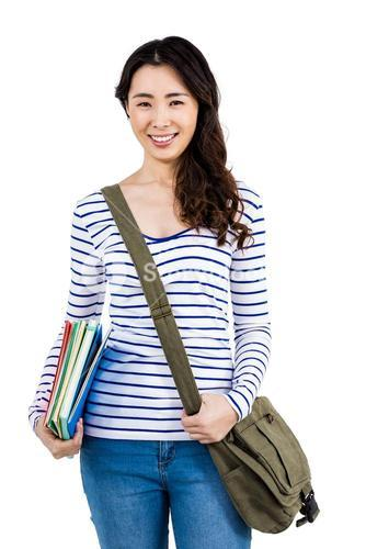 Cheerful woman with shoulder bag and files